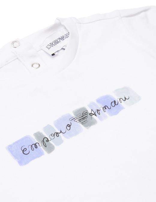 rinascente Emporio Armani Maglietta con logo su fondo acquarello