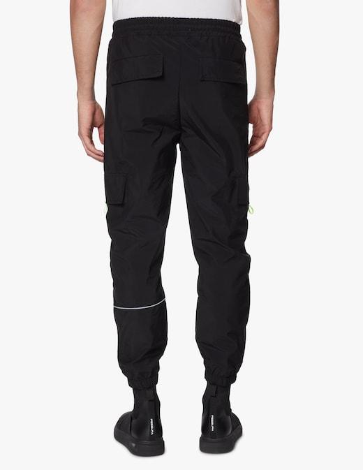 rinascente Disclaimer Pantaloni cargo in nylon con banda fluo